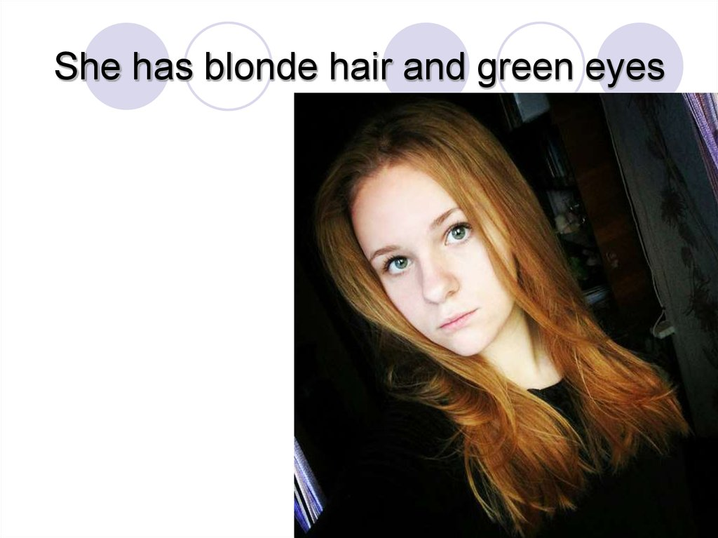 She has blonde hair and green eyes