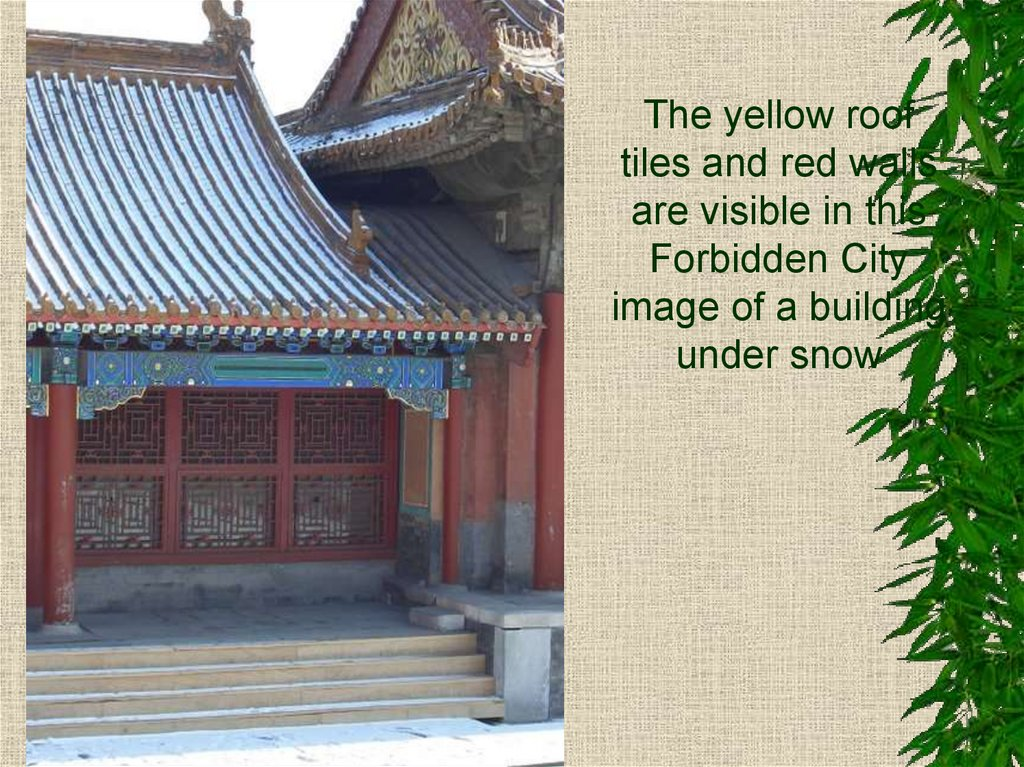 The yellow roof tiles and red walls are visible in this Forbidden City image of a building under snow