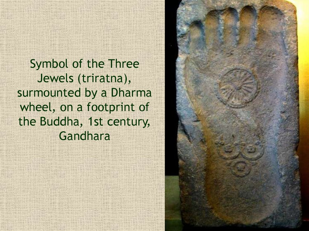 Symbol of the Three Jewels (triratna), surmounted by a Dharma wheel, on a footprint of the Buddha, 1st century, Gandhara