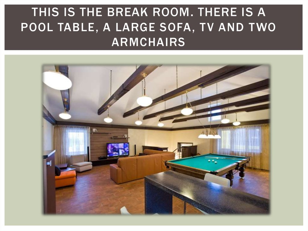 This is the break room. There is a pool table, a large sofa, TV and two armchairs
