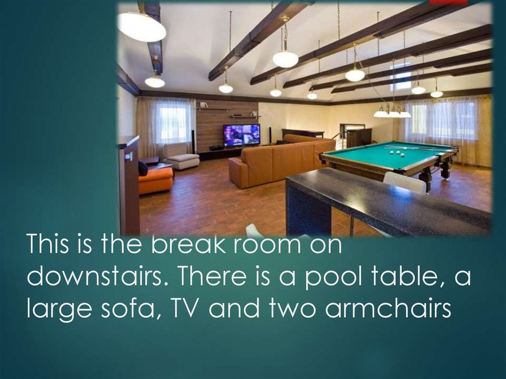 This is the break room on downstairs. There is a pool table, a large sofa, TV and two armchairs